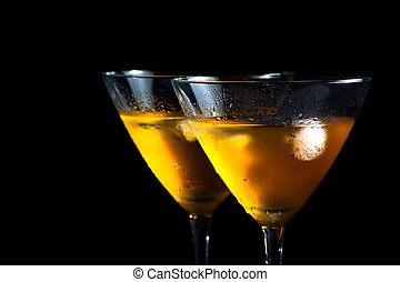 two glasses of fresh cocktail with ice