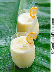 Two glasses of fruity banana smoothie - High angle view of ...