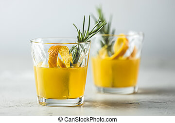 Two glasses of honey bourbon cocktail with rosemary simple ...