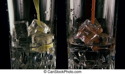 Two glasses of ice and vodka pour juice. Slow motion
