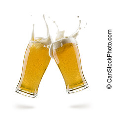 lager beer - two glasses of lager beer bumping on white ...