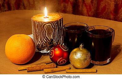 Two glasses of mulled wine and candle