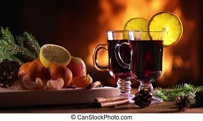 Two glasses of mulled wine (gluhwein) and a plate of fruit...