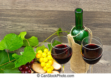 two glasses of red wine and grapes
