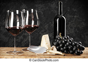 red wine - two glasses of red wine with cheese and grapes