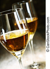 Two glasses of sherry on brown wooden background