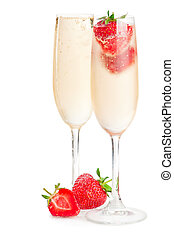 Two glasses of sparkling wine (champagne) and strawberry on...