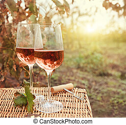 Two glasses of the rose wine in autumn vineyard. Harvest...