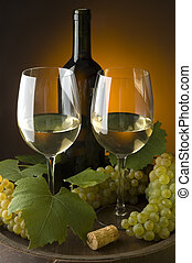 wine - two glasses of white wine with grapes