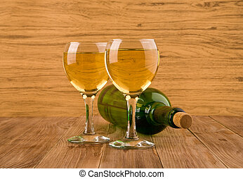 two glasses of wine and bottle
