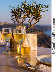 Two glasses of wine at sunset