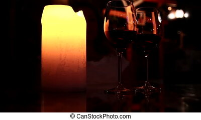 Two glasses of wine in the candlelight