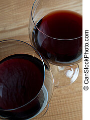 Two glasses of wine on wooden table