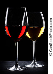 Two glasses of wine. One with red and the other with white