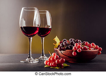 Two glasses of wine with grapes