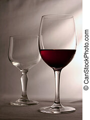 two glasses - one glass empty other one full