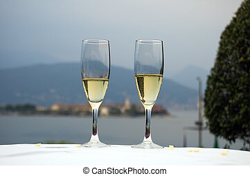 Two glasses of white wine in a restaurant on the lake Maggiore shore, Italy