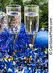Two glasses with blue Xmas decorations and tree 1