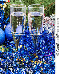 Two glasses with blue Xmas decorations and tree 2