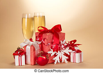 Two glasses with champagne and set of gift boxes