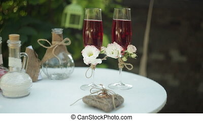 Two glasses with champagne on the table for the wedding ceremony