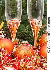 Two glasses with gold Xmas decorations and tree 1