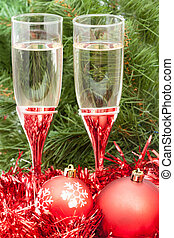 Two glasses with red Xmas decorations and tree 2