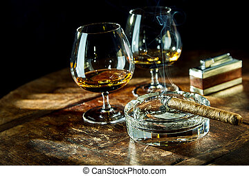 Two goblets of liquor besides smoking cigar