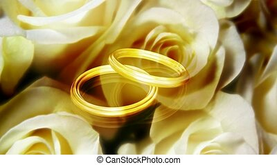 Two gold rings with white roses as background