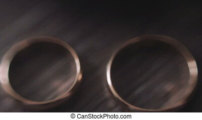 Two Gold Wedding Rings on The Table