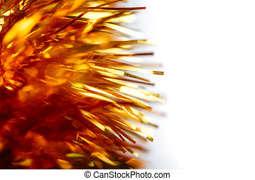 Two golden Christmas tinsels. Isolated on white background