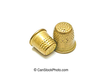 two golden metal thimbles