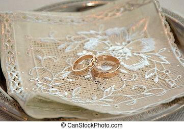 Two Golden Wedding Rings on table macro shot