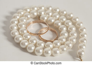 Two golden wedding rings with Pearl necklace