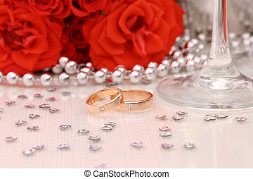 Two golden wedding rings with red roses - Two golden wedding...