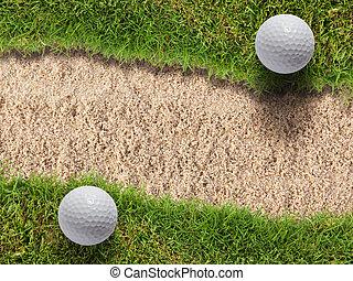 Two golf ball on green grass near sand bunker