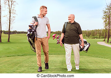 Two golf players walking through course