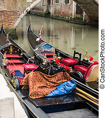 Two gondolas moored along a canal  in Venice