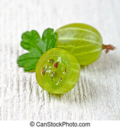 two gooseberries with leaves