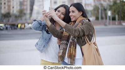 Two gorgeous women posing for a selfie