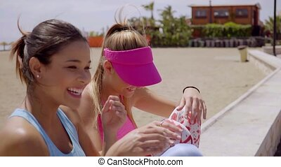 Two gorgeous women relaxing in the summer sun - Two gorgeous...