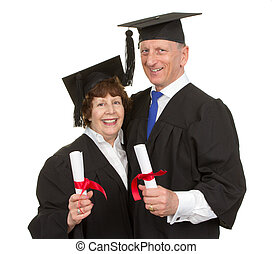 Two graduates with scrolls