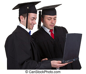 Two graduates working together on a laptop, isolated on white