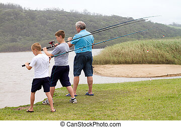 two grandsons fishing with grandpa