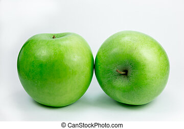 Two granny smith apples in different angles on a white...