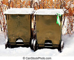 Two green bins on wheels for recycling