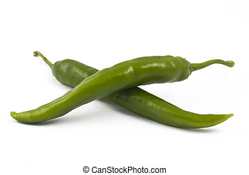 Two green chili peppers on white