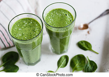 Two green smoothie in the glass - Two green smoothie with...