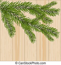 Two green spruce branches on the background of wood...