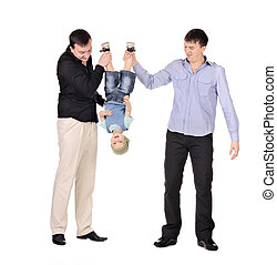 Two gusd holding little boy upside down